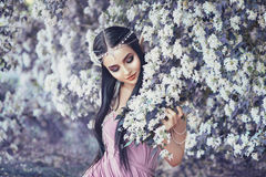 Portrait of an elf in a blooming garden Stock Images