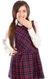 Portrait of embarrassed schoolgirl holding hand over her mouth Royalty Free Stock Image