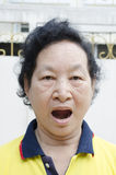 Portrait of emotion Asian senior woman with yawn expression royalty free stock photo