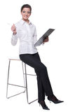 Portrait of emotional business woman on chair Royalty Free Stock Photos