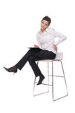 Portrait of emotional business woman on chair Royalty Free Stock Photography