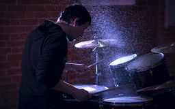 Portrait of emotional drummer rehearsing on drums. Royalty Free Stock Photo
