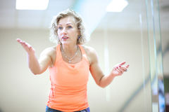 Portrait of an emotional female fitness trainern Stock Image