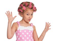Portrait of emotional little pretty girl with hair curlers on white background stock photos