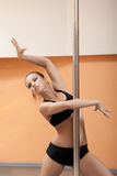 Portrait of emotional pretty pole dancer Stock Photos