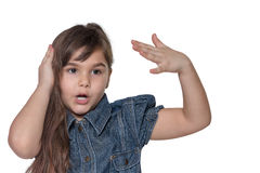 Portrait of emotionally gesticulating  little girl isolated. Portrait of emotionally gesticulating brunette long haired little girl isolated on the white Stock Photography