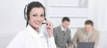 Portrait of an employee call center in the background of the of Royalty Free Stock Photo
