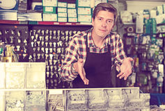 Portrait of employee selling nuts, and fasteners Royalty Free Stock Image