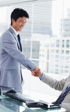 Portrait of an employee shaking the hand of his manager Stock Photos