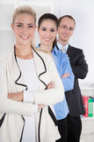 Portrait of employees in an office - woman and man. Royalty Free Stock Photo