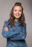 Portrait of energetic fun girl student on a gray background in a Royalty Free Stock Photos