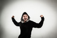 Portrait of a energetic guy rapper on a light background. Energetic guy rapper on a light background.the photo has a empty space for your text royalty free stock photography
