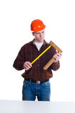 Portrait of an engineer in helmet making measurements using roul Royalty Free Stock Photography