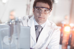 Portrait of an engineer in his working environment. Portrait of a confident male engineer in his working environment. Science and technology concept Stock Photography