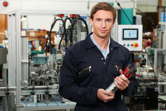 Portrait Of Engineer Holding Component In Factory Stock Photography
