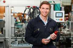 Portrait Of Engineer Holding Component In Factory Royalty Free Stock Photography