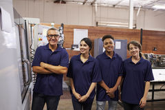 Portrait Of Engineer Training Apprentices On CNC Machine Royalty Free Stock Photos
