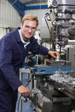 Portrait Of Engineer Using Drill In Factory Royalty Free Stock Images