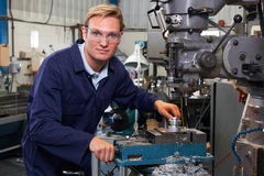 Portrait Of Engineer Using Drill In Factory Royalty Free Stock Image