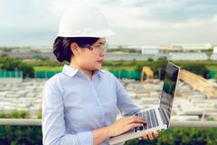 Portrait of engineer woman is using laptop inspection precast co stock photo