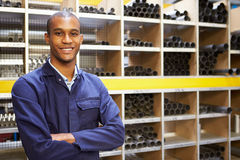 Portrait Of Engineering Worker In Store Room. With Arms Crossed Smiling To Camera Stock Image
