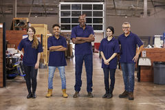 Portrait Of Engineers And Apprentices In Busy Factory Stock Photography