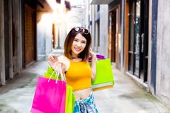 Portrait enjoy shopping beautiful woman. Charming beautiful woman love shopping when gorgeous girl buy favorite goods, she gets h stock photo
