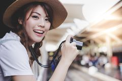 Portrait enjoying life of beautiful traveler woman. Charming beautiful girl is taking tourist location photo at vintage or old tr stock photography