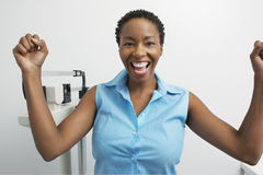 Portrait Of Enthusiastic Woman With Scales Stock Images