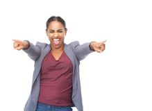 Portrait of an enthusiastic young woman pointing fingers. Closeup portrait of an enthusiastic young woman pointing fingers on isolated white background Royalty Free Stock Images