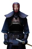 Portrait of equipped kendo fighter with shinai Stock Photos