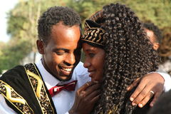 Portrait of a Ethiopian couple on their wedding day. The bridegroom wraps his arms around the bride during the wedding ceremony in southern Ethiopia, near Arba royalty free stock photos