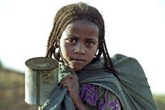 Portrait of Ethiopian girl fetching water. Ethiopia, region Oromia, village CHANCHO Gaba Robi: Portrait Oromo girl, the largest Ethiopian ethnic population group Stock Photos