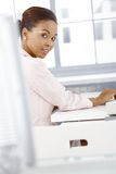 Portrait of ethnic businesswoman at desk Royalty Free Stock Photography