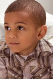 Portrait of ethnic little boy in checkered shirt Royalty Free Stock Photography