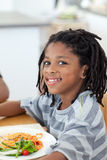 Portrait of ethnic little boy dining Stock Image