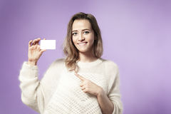 Portrait of european business woman holding credit card. Royalty Free Stock Photo