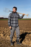 Portrait of a european Farmer with a pitchfork Stock Photo