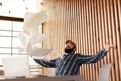 Portrait of european man with beard, paper throw, celebrating