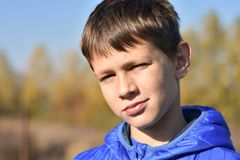 Portrait of a European teenager in a jacket. Portrait of European teenager in a jacket in the autumn in nature stock photography