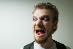 Portrait of evil, aggressive man with makeup Royalty Free Stock Image