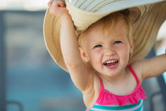 Portrait of excited baby in beach hat Royalty Free Stock Image