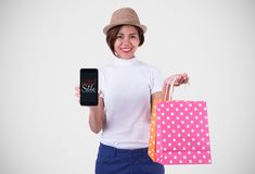 Portrait of an excited beautiful asian girl wearing dress and sunglasses holding shopping bags while standing at fashion mall stock photos