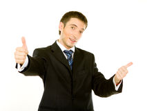 Portrait of a excited business man. Showing a success sign, isolated on white background Stock Photo