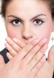 Portrait of excited business woman covering her mouth by the hand. Over white background Stock Images
