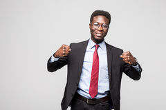 Portrait of an excited businessman with arms raised in success on white background. Excited businessman with arms raised in success on white background Stock Photo