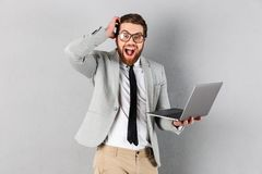Portrait of an excited businessman dressed in suit stock images