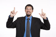 Portrait of a excited businessman pointing upwards Stock Image