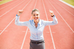 Portrait of excited businesswoman standing on the running track Stock Photography