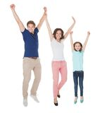 Portrait of excited family jumping Stock Photography